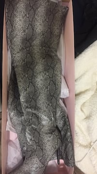 gray and black snakeskin knee-high booties