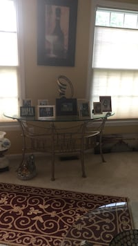Brown wooden framed glass top table