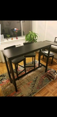 Black bar table with matching bar stools