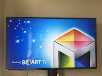Smart TV 65+Tv Stand brand new with the box  Alexandria, 22303