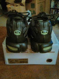pair of black-and-green Nike basketball shoes 31 mi