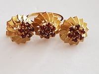 gold-colored and red gemstone encrusted stud earrings and ring se
