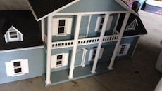 blue, white, and black house model figure