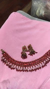 red-and-gold-colored beaded necklace and earrings set