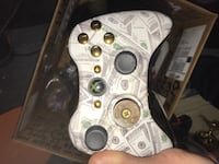 white and black Xbox 360 controller