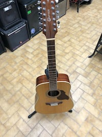 brown and black acoustic guitar Longueuil, J4K 3T6
