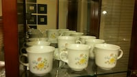 white-and-yellow floral ceramic mugs