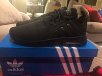 Black adidas low top sneakers on box Kitchener, N2P 2V4