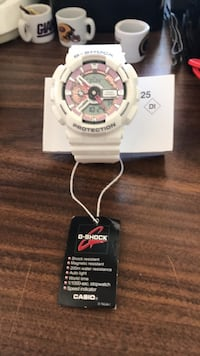 Casio G-shock.  White and rose gold. New. No box. Has manual  Modesto, 95350