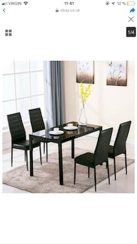 Black Tempered Glass Table With 4 Faux Leather Chairs