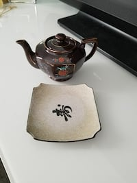 square white and brown Chinese calligraphy printed ceramic plate and brown floral ceramic kettle