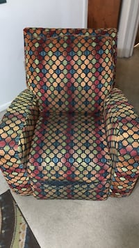 brown, red and green printed armchair