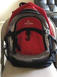 red and gray Teton backpack
