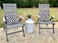 two gray wooden armchairs