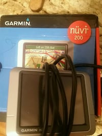 black and gray Garmin Nuvi GPS navigator box 2274 mi