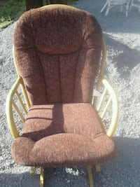 brown and gray fabric padded glider chair