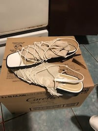 pair of brown leather flat shoes with box Everett, 02149