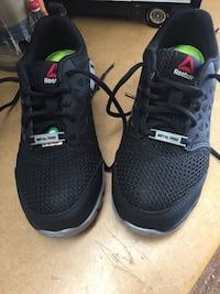 pair of black-and-green Nike sneakers Newcastle, L1B 1K5