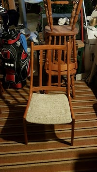 4 brown wooden windsor chairs