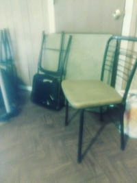Four meatl chairs that fold and table  Fort Smith, 72904