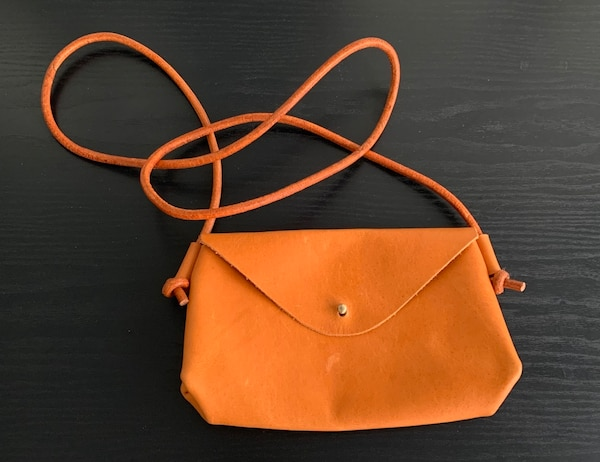 Handcrafted natural tan leather crossbody purse. f26b5a56-5b98-41b3-98ee-0e75cb8f12a2