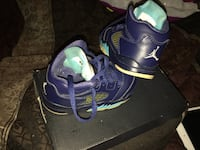 Pair of purple-and-green nike running shoes West Palm Beach, 33415