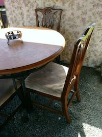 oval brown wooden table with four chairs dining set New Iberia, 70560