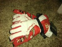 white and red leather gloves