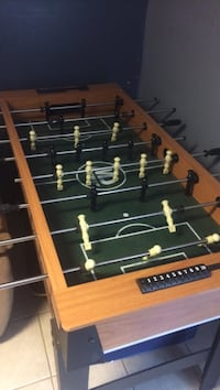 brown and green wooden foosball table New York, 11422