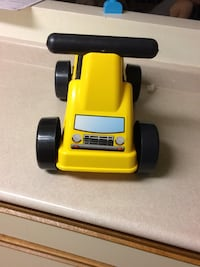 yellow and black plastic toy car