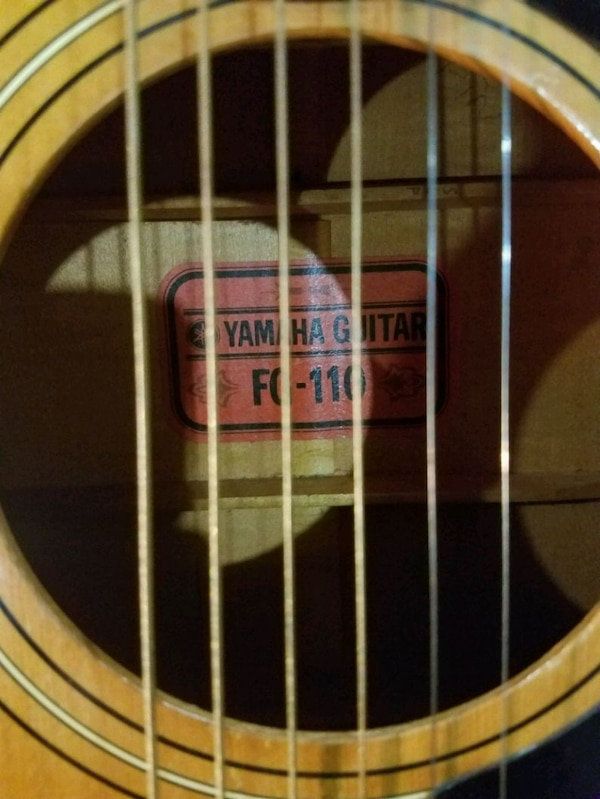 Yamaha, vintage, RED LABEL,  fg110 acoustic  with hard she'll case.  64cdf11e-d26e-4175-b1ca-47650d23c818