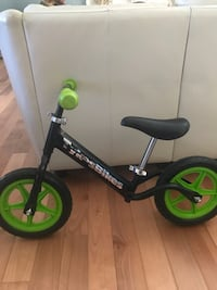 black and green Strider balance bike Pitt Meadows, V3Y 1M6