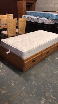 white and brown ottoman bed