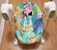 Baby's green, blue and white animal print cradle and swing