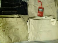three khaki work pants and one blue jeans
