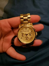 round gold-colored chronograph watch with link bra Morristown