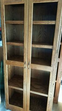Tall wooden bookcase with glass doors Tinley Park