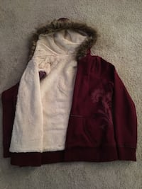 Women's warm lined jacket with hood. Size large, no stains or tears. Excellent condition 50 km