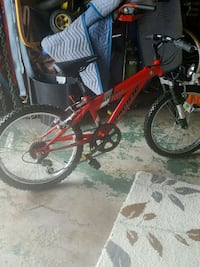 red and black hardtail mountain bike 909 mi