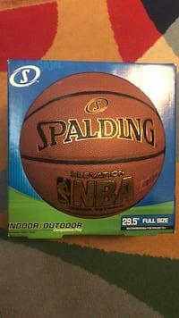 Round brown and black spalding basketball College Park, 20740