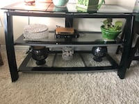 Glass TV Stand only 5months old. Excellent Condition. Pick up only! Price is non negotiable  Edmonton