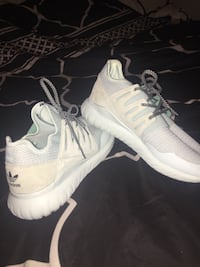 Pair of white nike running shoes