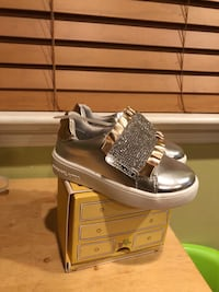 pair of silver-colored high top sneakers Falls Church