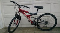 red and black full suspension mountain bike Pittsville, 21850