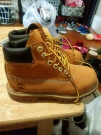 pair of brown Timberland work boots 416 mi