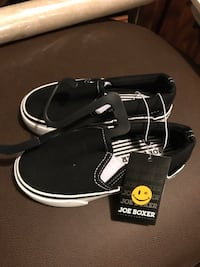 pair of black-and-white Nike shoes 2050 mi