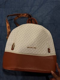 brown and gray Michael Kors leather backpack 5 mi