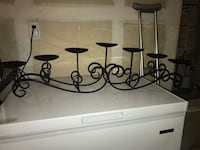 black metal candle holder with two pillar candles 1290 mi