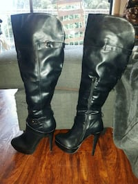 pair of black leather knee high boots Langley, V3A 4K9