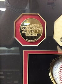 2004 Red Sox World Series team autographed baseball numbered in shadowbox with commemorative coins from the World Series  Manchester, 03101